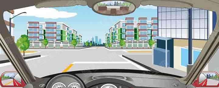 驾驶机动车直行通过前方路口怎样行驶?