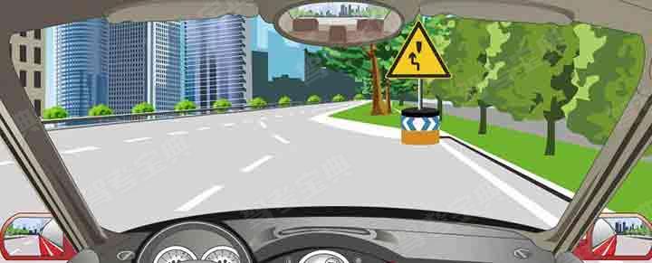 图中标志提醒障碍物在路中,车辆从右侧绕行。